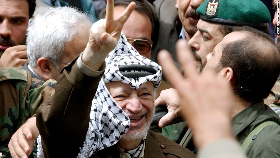 Arafat greets supporters in Ramallah on May 2, 2002, after Israeli soldiers withdrew from his compound late the previous night.