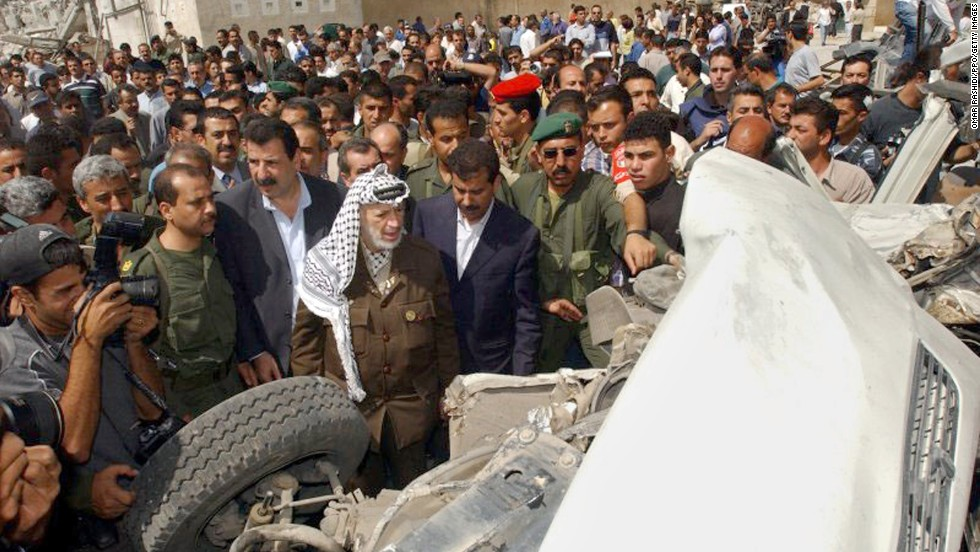 Arafat tours damage at his compound after it was attacked by Israeli troops on June 6, 2002 -- this time in retaliation for a suicide bombing that killed 17 Israelis, 13 of them soldiers.