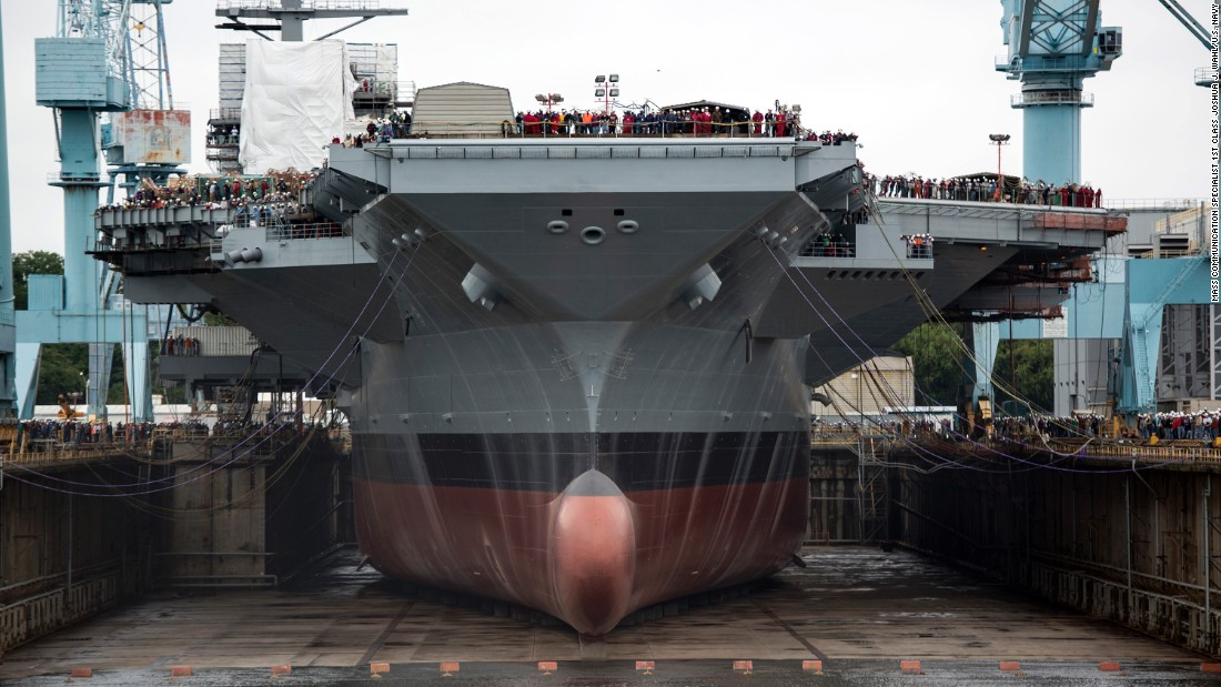 Shipbuilders in Newport News, Virginia, prepare to flood a dry dock, on November 9, 2013, to float what will be the USS Gerald R. Ford, the first ship in the U.S. Navy's newest class of aircraft carriers.