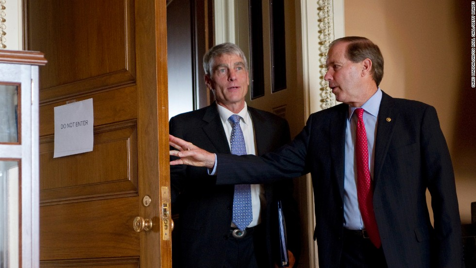 Sen. Mark Udall, D-Colorado, and his cousin Sen. Tom Udall, D-New Mexico, attend a weekly Senate policy luncheon in Washington on May 15, 2012.