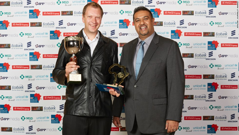 """Photojournalist Adrian de Kock (left) wins the Mohamed Amin Photographic Award for his entry """"The Jump that Started it All."""""""