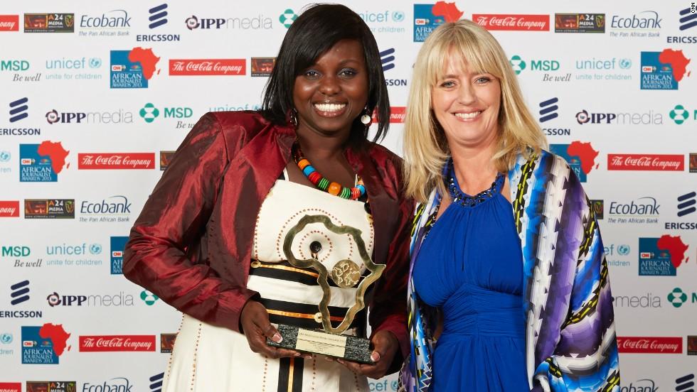 Gifty Andoh Appiah (left), from Joy News TV in Ghana, won the Television News Bulletin Award and was presented the award by Deborah Rayner, CNN International.