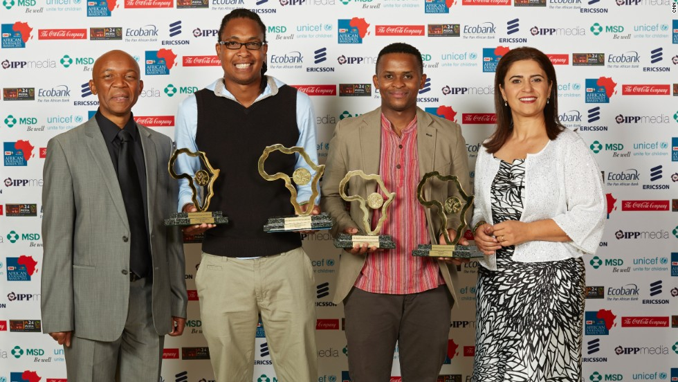 """The Overall Winners: Msindisi Fengu (centre left) and Yandisa Monakali (centre right) from Daily Dispatch in South Africa, won for their investigation series """"School Hostels of Shame."""" The pair also jointly won the Print General News Award."""