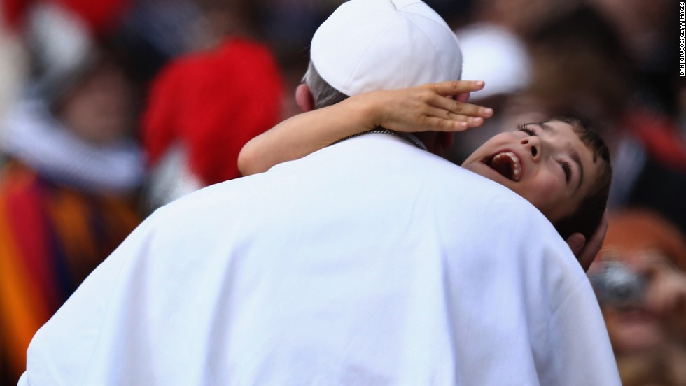 "Pope Francis embraced a young boy with cerebral palsy in March 2013, a gesture that many took as a heartwarming token of his self-stated desire to ""be close to the people."""