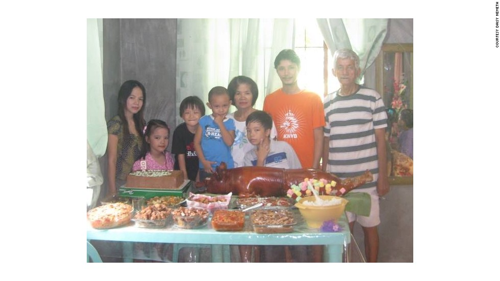 Tan, 68, is seen on the right of this photo. His children and grandchildren also went missing after Friday's Super Typhoon smashed into the coast, flattening houses and bringing a storm surge that killed hundreds, if not thousands, of people.