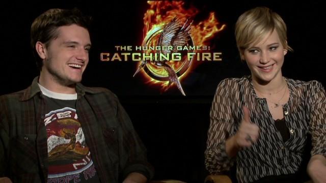 Peeta dishes on kissing Katniss