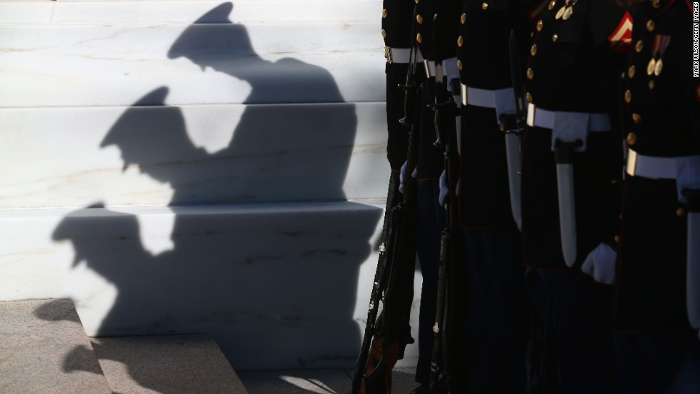 Members of the military stand at attention before Monday's ceremony at the Tomb of the Unknowns.