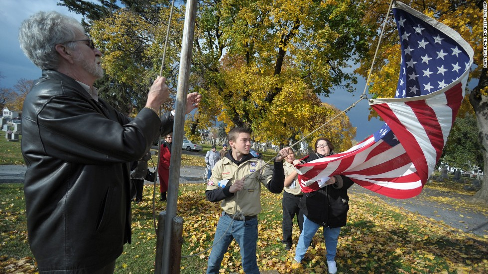 Boy Scouts in Easton, Pennsylvania, raise an American flag during a Veterans Day program on Sunday, November 10.
