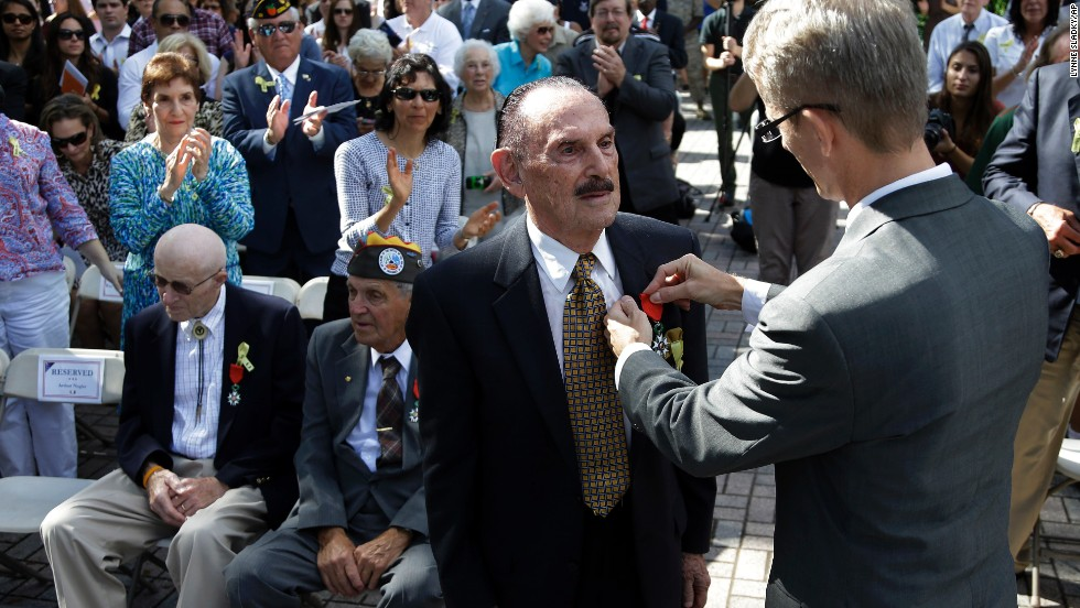 World War II veteran Arthur Nagler is presented with a Legion of Honor medal by Philippe Letrilliart, the consulate general of France in Miami, during a Veterans Day ceremony Monday in Coral Gables, Florida.
