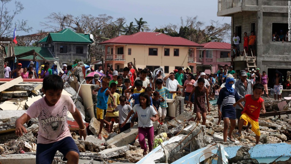 Villagers in Hernani, Philippines, run toward government officials hoping for food November 11.