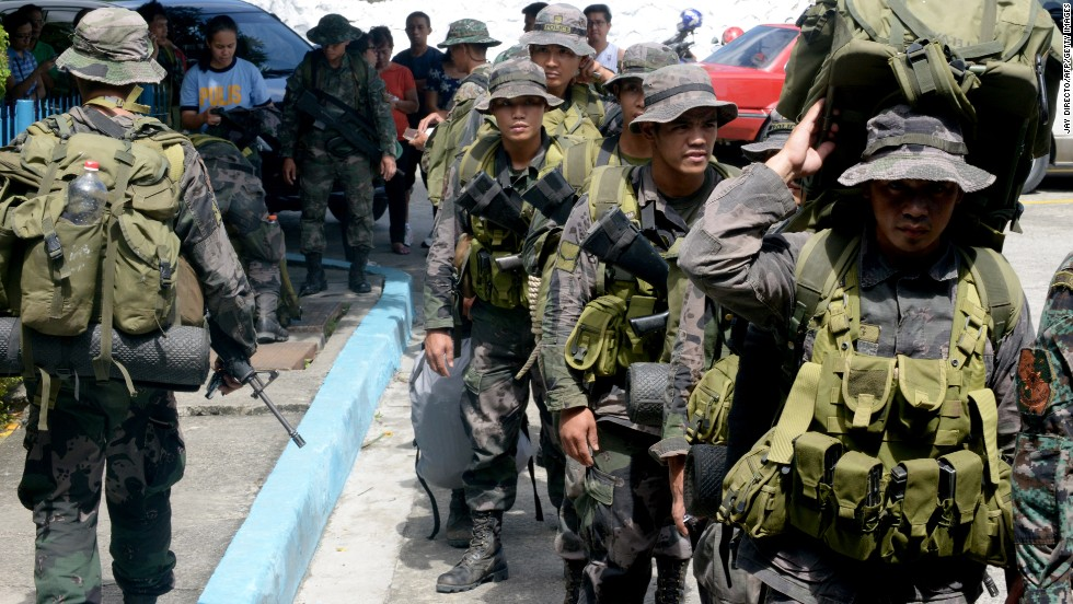 Philippine police commandos prepare to board a military plane in Manila on Sunday, November 10.
