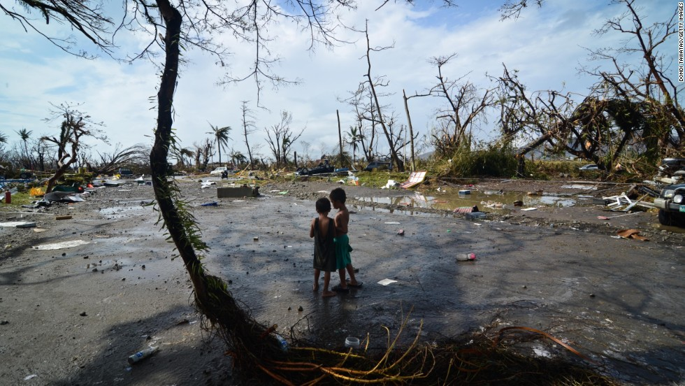 Two young boys look at the devastation in Tacloban on November 10.