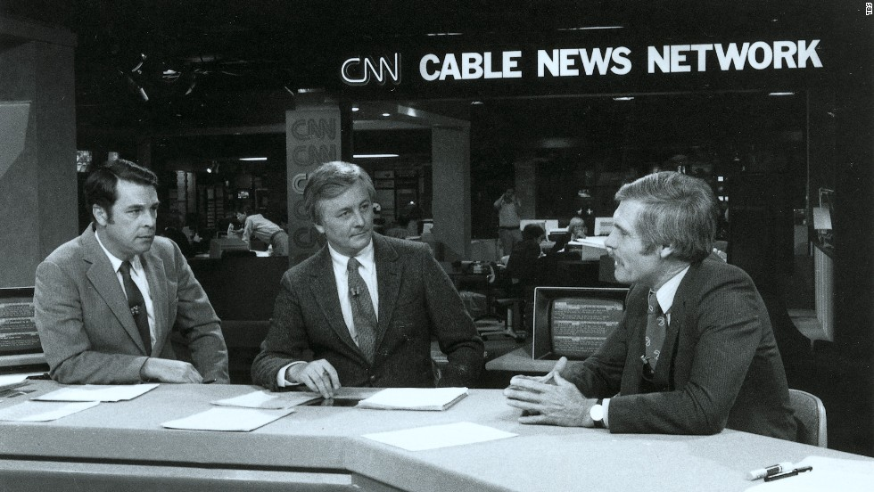 Turner, right, talks on the set of an early CNN broadcast.