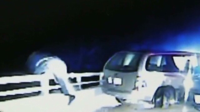 earlystart vo dashcam police falls over guard rail_00001916.jpg