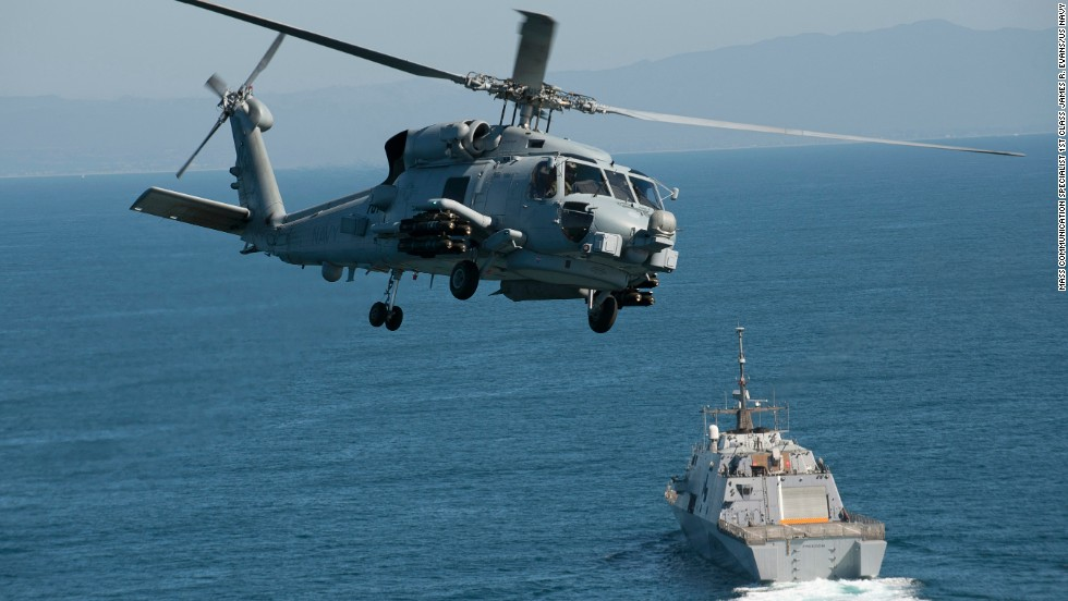 An MH-60R Seahawk flies near in the Pacific Ocean in February.