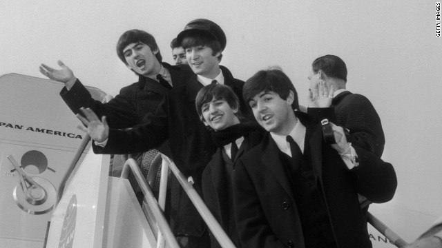 The Beatles prepare to leave for America in early 1964.