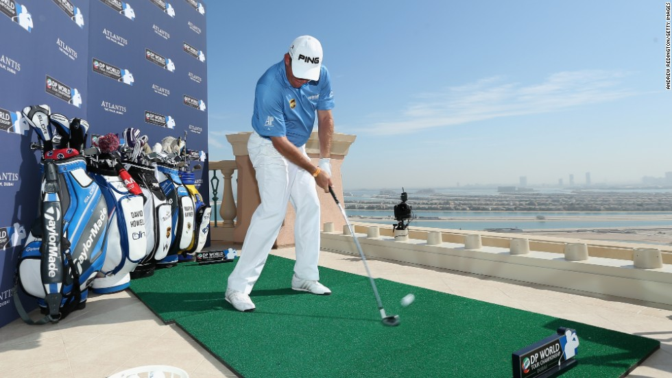 England's Lee Westwood, also a former world No. 1, set the early pace, smashing a seven iron to within eight feet of the pin.