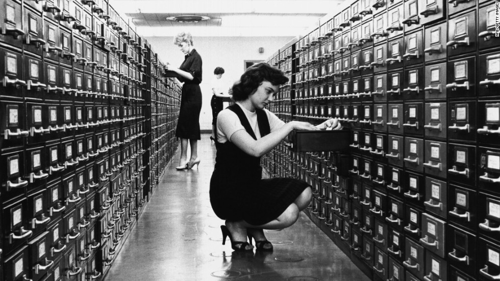 "Then: The card catalog was a formidable piece of furniture found at every library. On its thousands of cards: title, author, subject and call number -- sometimes with handwritten notations. Now: Google. The world's knowledge at your fingertips. So much for roaming the aisles of the <a href=""http://www.oclc.org/en-US/dewey/resources/summaries.html"" target=""_blank"">Dewey Decimal System</a>."