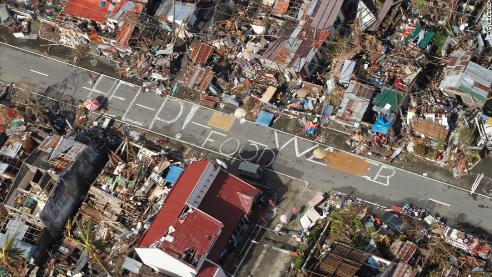 An aerial view of Tanuan shows signs pleading for help and food November 13.