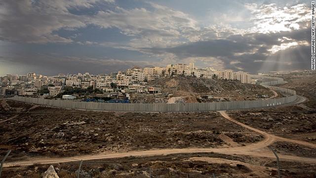 Israel's controversial separation barrier surrounds the Ras Khamis neighbourhood of East Jerusalem, on November 12, 2013.