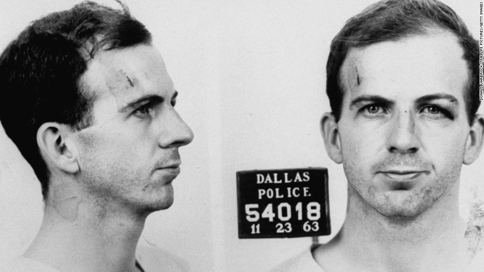 Police mug shot of Lee Harvey Oswald. He is arraigned in the slaying of Officer Tippit on November 22 and/or the murder of the president the next day. As Oswald is being transferred from the Dallas city jail to the county jail, nightclub owner Jack Ruby shoots and kills him, an event captured live on TV. Ruby is arrested immediately.
