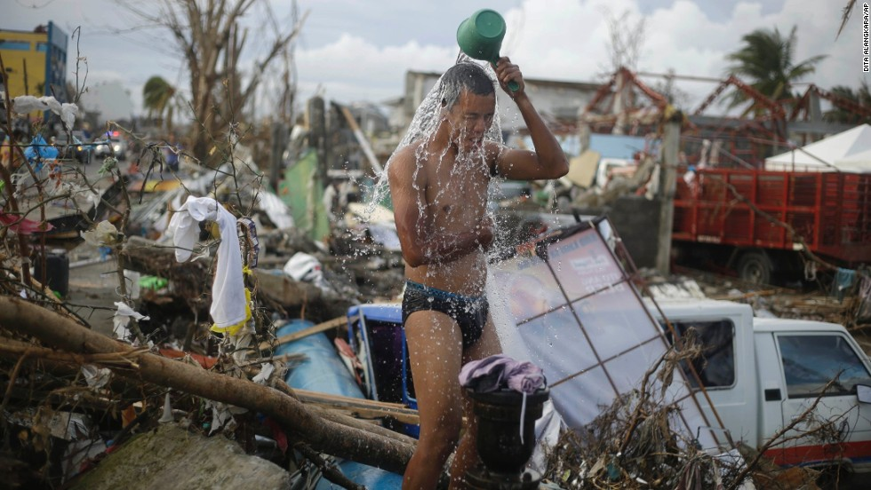A man takes a shower amid the rubble in Tacloban on November 13.