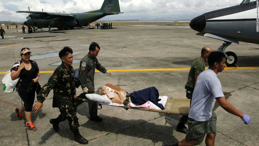Soldiers transport a sick survivor November 13 in Tacloban.