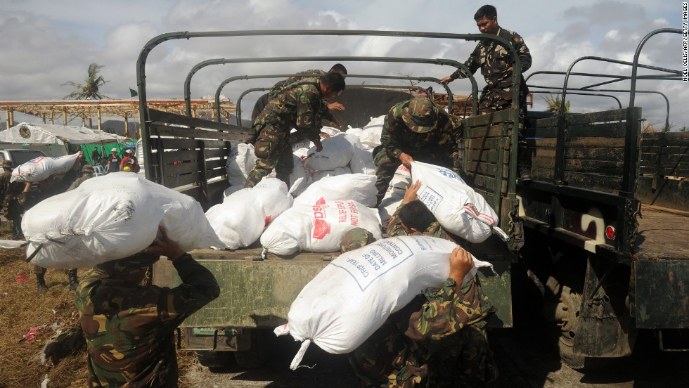 Soldiers load relief goods onto a truck in Tacloban on November 13.