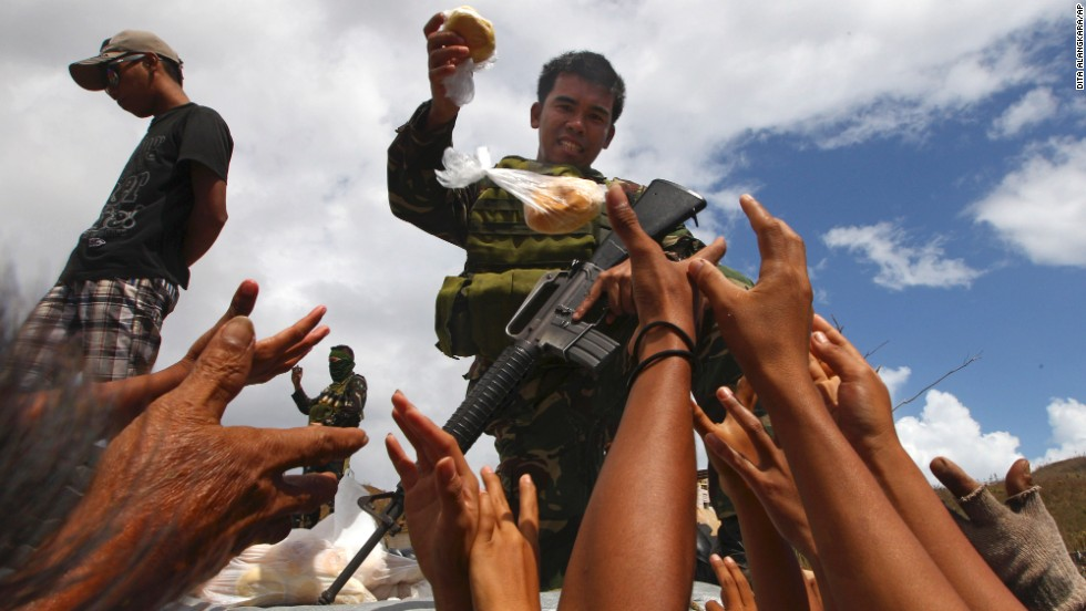 A Filipino soldier hands out bread to survivors in Maraboth, Philippines, on November 14.