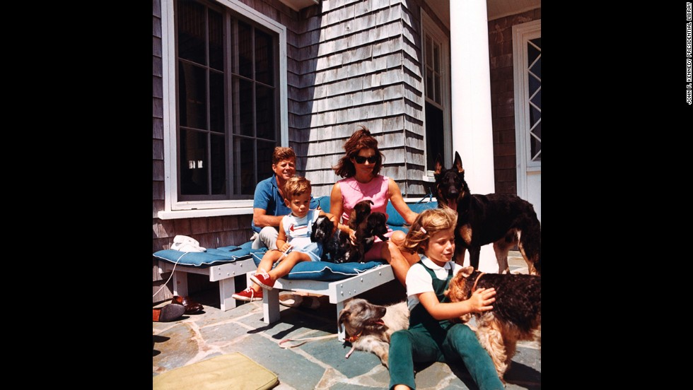 President Kennedy, John F. Kennedy Jr., Jackie and Caroline with puppies Blackie and White Tips, and family dogs Shannon, Clipper, Wolfie and Charlie on August 14, 1963.