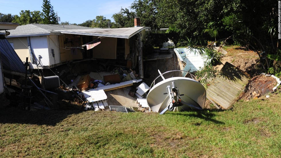 The rear portion of a residential home is consumed by a sinkhole November 14 in Dunedin, Florida.