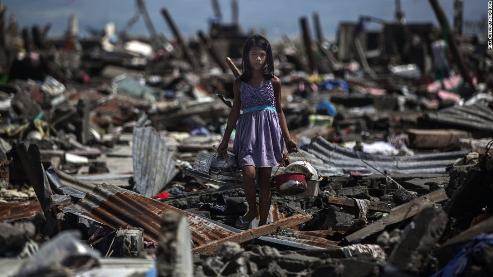 Nina Duran searches for belongings at her family's destroyed house in Tacloban on November 13.