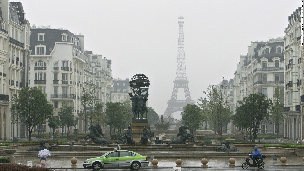 There's another Eiffel Tower, looking slightly melancholic in the gray gloom, in the eastern Chinese city of Hangzhou.