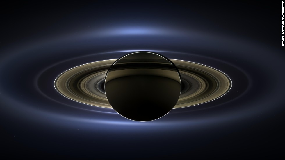 "NOVEMBER 14 - IN SPACE: <a href=""http://cnn.com/2013/11/13/us/nasa-saturn-earth-picture/"">NASA has unveiled this image of the planet Saturn</a> back lit by the sun. The photo was taken four months ago from the Cassini spacecraft. The ringed planet spans 404,880 miles (651,591 kilometers) across and Mars, Venus and Earth, are also visible in the picture."