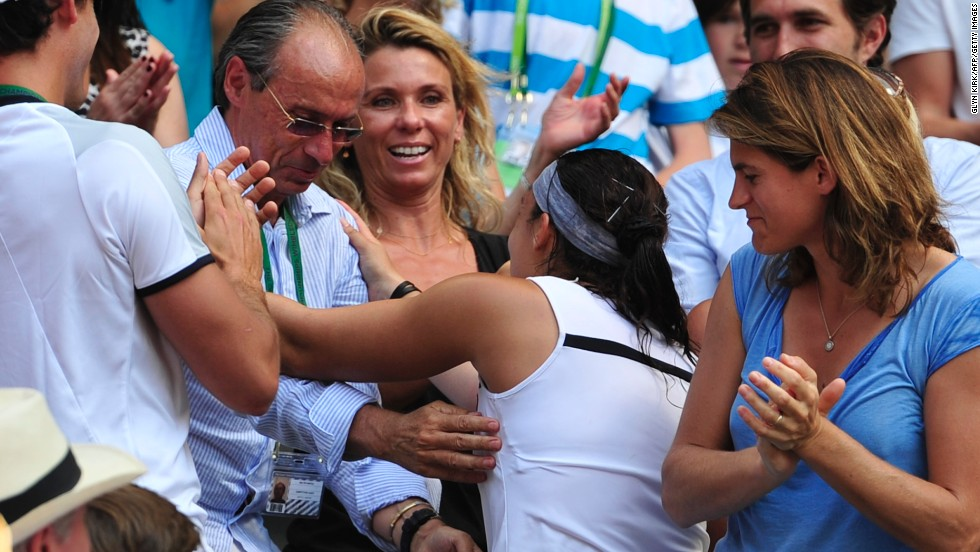 Bartoli made her way to her player box after the final and exchanged hugs with her team, which included dad Walter (middle) and former Wimbledon champion Amelie Mauresmo (right). Walter coached his daughter from a young age.