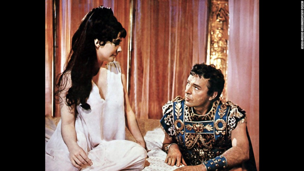 "Elizabeth Taylor and Richard Burton appear in a publicity still for the film ""Cleopatra,"" which premiered on June 12, 1963. The historical drama, directed by Joseph L. Mankiewicz, starred Taylor as Cleopatra, and Burton as Mark Antony."