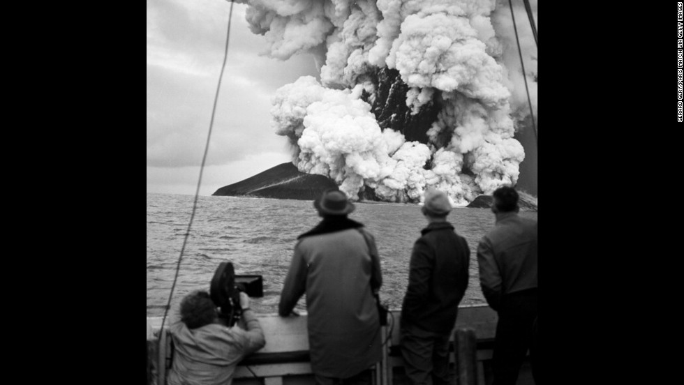 Pierre Mazeaud, Gerard Gery, and Philippe Laffon watch as a new island, Surtsey, is formed from volcanic eruptions off the coast of Iceland on December 2, 1963.