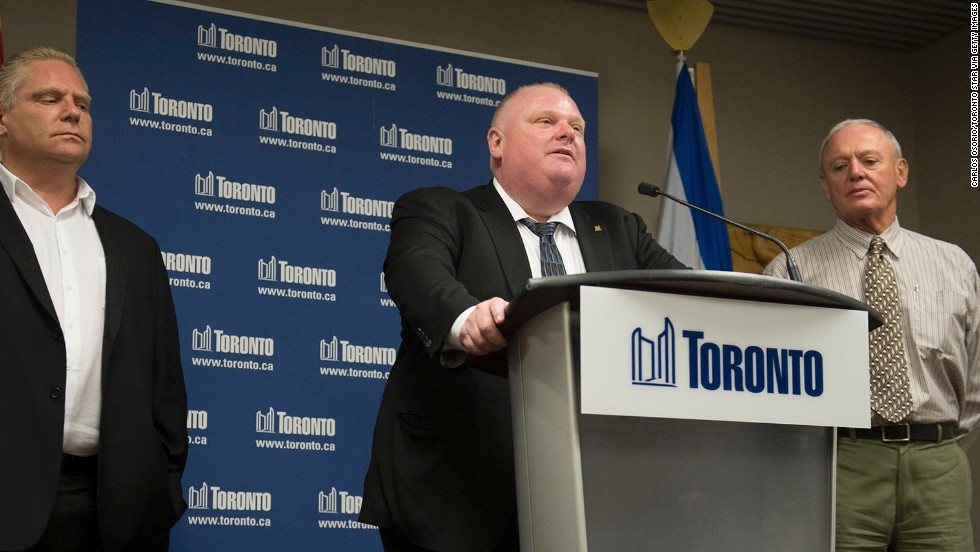 Ford denies using crack during a news conference at City Hall in May 2013. On his right is Deputy Mayor Doug Holyday and on his left is his brother Councilor Doug Ford. Allegations that the mayor had been caught on video smoking crack surfaced in news reports in May. Ford initially insisted the video didn't exist.