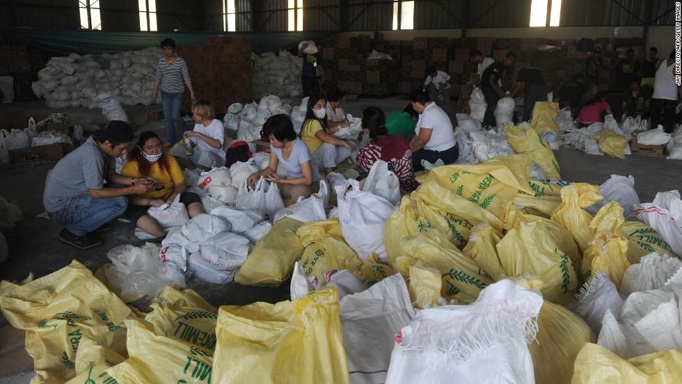 Volunteers in Manila, Philippines, prepare relief goods for typhoon survivors on Thursday, November 14.