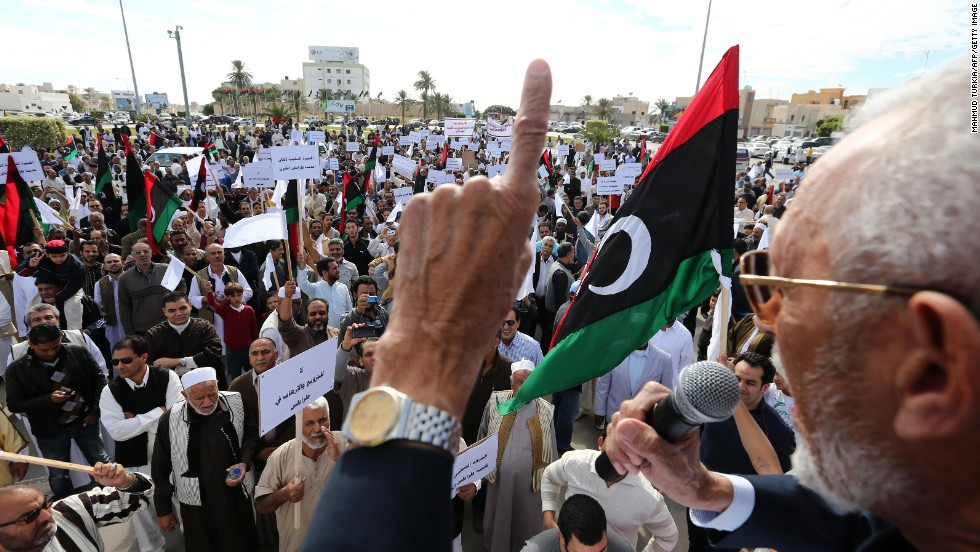 Libyan protesters gather during a demonstration calling on militiamen to vacate their headquarters in southern Tripoli on November 15, 2013.