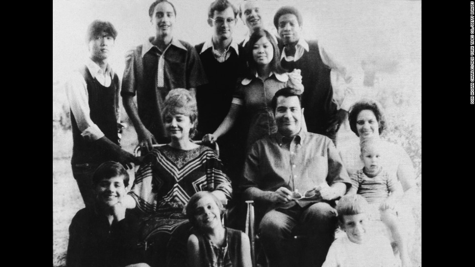 A portrait shows Jim Jones, the founder of the People's Temple, and his wife, Marceline Jones, seated in front of their adopted children and next to his sister-in-law, right, with her three chilldren. Jones relocated the People's Temple from San Francisco to Guyana.