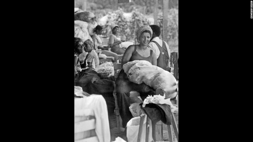 Members mend old clothes in a house in Jonestown.