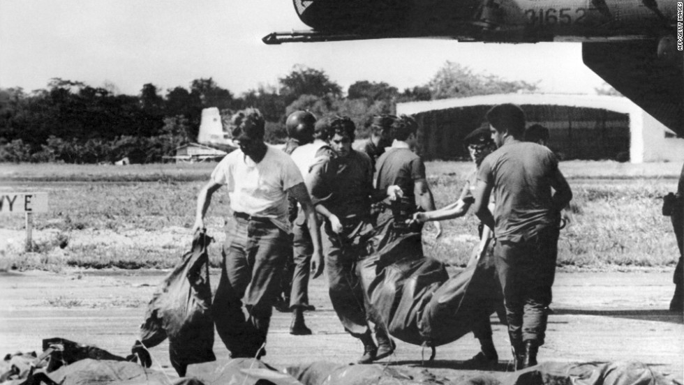 U.S. military personnel remove bags containing bodies of members of the cult on November 23, 1978.