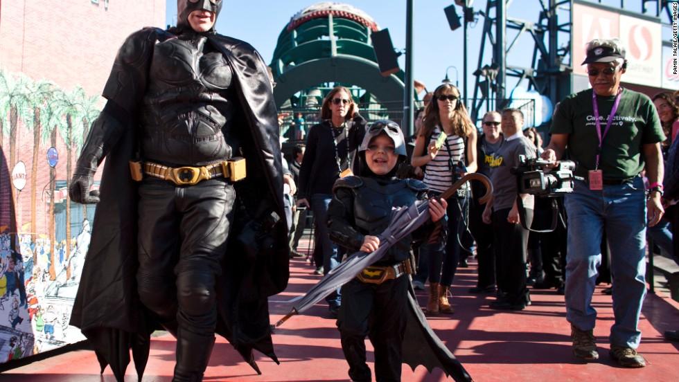 Miles walks with Batman.