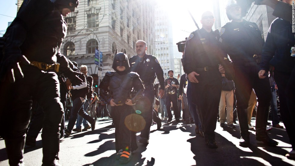 Miles and Batman walk the streets of San Francisco.