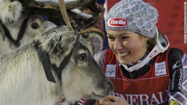 Mikaela Shiffrin makes friends with her prize Rudolph the reindeer after winning the World Cup slalom in Levi.