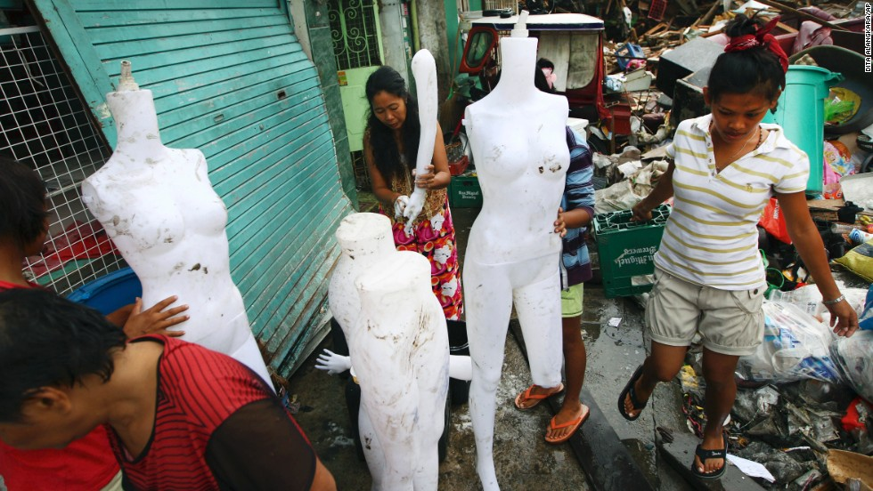 Survivors clean mannequins found among the debris in Tacloban on November 17.