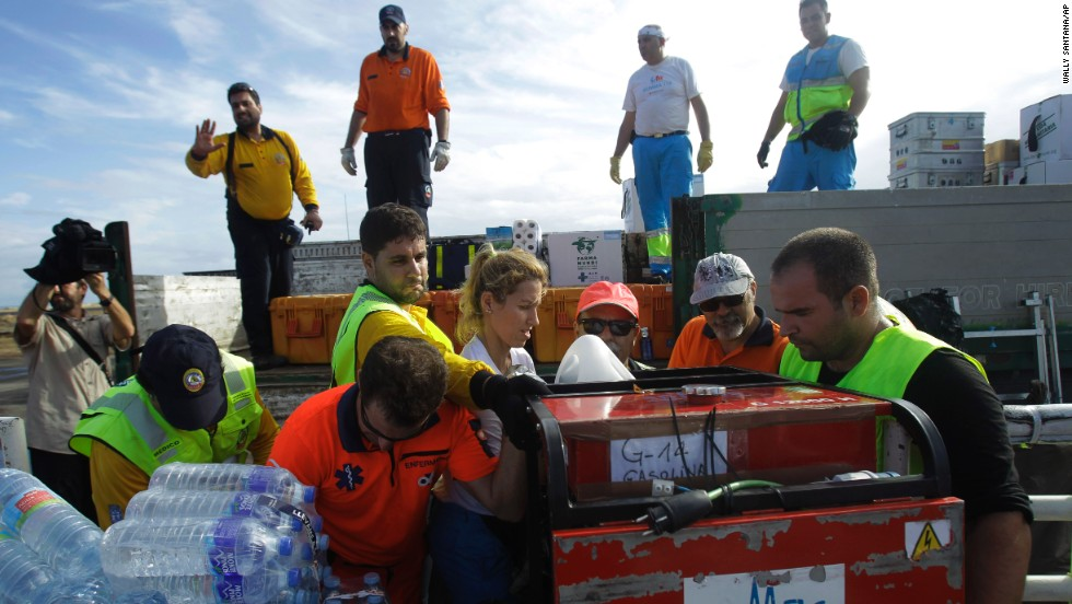 An emergency team from Spain unloads relief supplies November 17 in Tacloban.