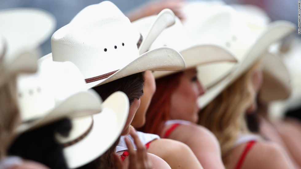 Cowboy style hats are very appropriate headwear for the grid girls to wear in the paddock at the United States Grand Prix in Texas.