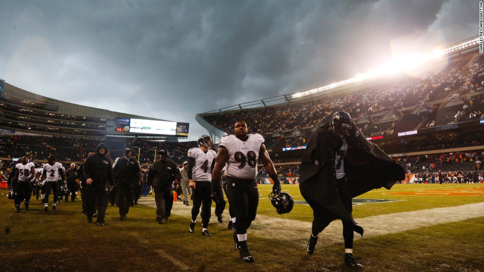 Baltimore Ravens players leave the field after the game was delayed on November 17.